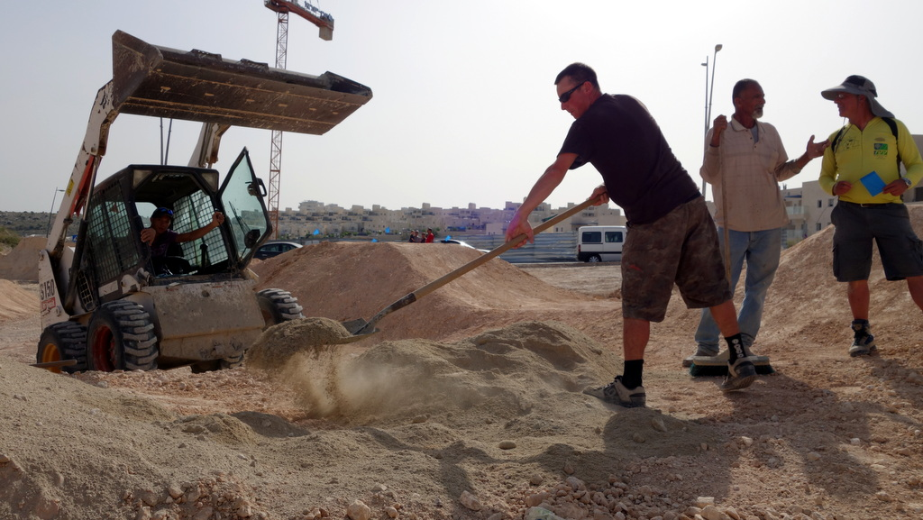 Mark McClure getting his hands dirty in Modiin, Israel